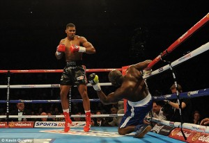 Joshua knocks down Johnson
